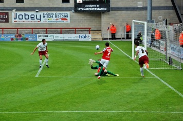 Morecambe's Jack Redshaw Curls the Ball Wide of Far Post