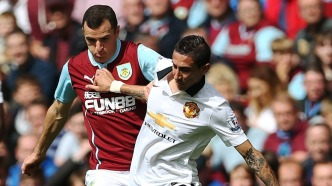 Manchester United's Argentinian midfielder Angel di Maria (R) vies with Burnleys English midfielder Dean Marney (L) during the English Premier League football match between Burnley and Manchester United at Turf Moor in Burnley, north west England on August 30, 2014. AFP PHOTO / IAN MACNICOL..RESTRICTED TO EDITORIAL USE. No use with unauthorized audio, video, data, fixture lists, club/league logos or live services. Online in-match use limited to 45 images, no video emulation. No use in betting, games or single club/league/player publications (Photo credit should read Ian MacNicol/AFP/Getty Images)